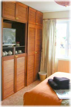 the downstairs bedrooms - built in wardrobes